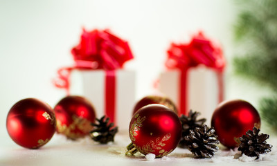 gifts on a white background with Christmas balls
