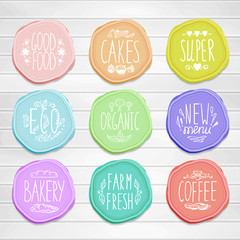Set of retro badges with hand-drawn lettering on a wood