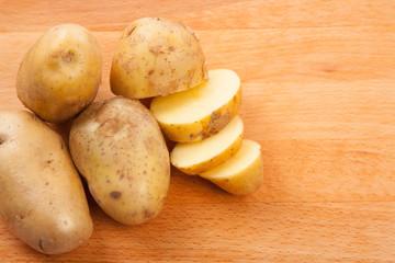 Cut potatoes on cutting board
