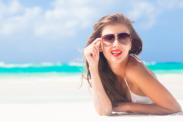 portrait of long haired girl in bikini wearing red lips on