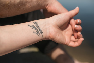 arm with tattoo