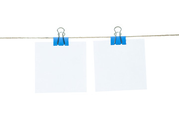 White paper cards hanging on a rope