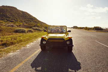 Young couple on road trip in beach buggy