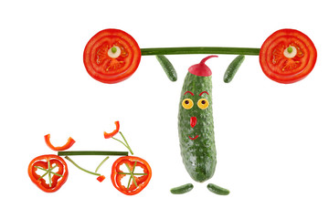 Little funny cucumber raises the bar next to it stands  a bicycl