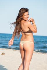 Beautiful bikini model posing on the beach
