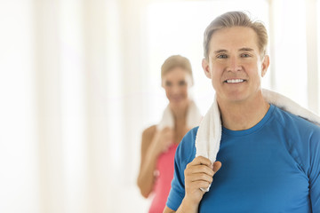 Fit Mature Woman Holding Towel With Woman In Background