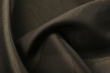soft bends of black satin