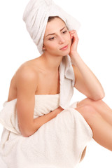 beautiful woman in spa wrapped in towel