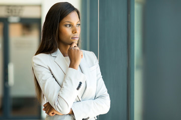 african businesswoman looking through window