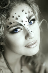 Beauty woman with makeup in snow leopard style. Fashion makeup m