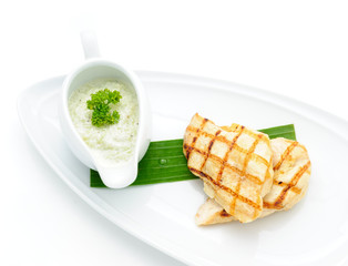 Grilled chicken with tartar sauce studio shot