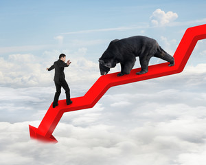 Businessman against bear on arrow downward trend line with sky