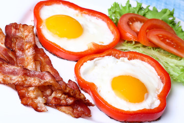 Breakfast fried eggs, bacon, tomatoes and lettuce