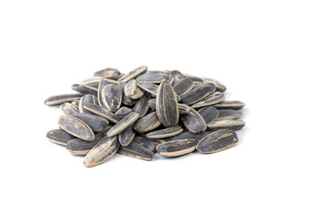 sunflower seeds pile against white background