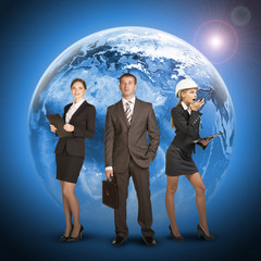 Three business person standing on background of Earth