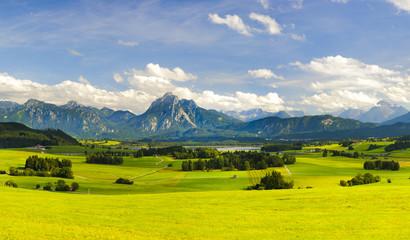Wall Mural - Panorama Landschaft in Bayern mit Berge der Alpen bei Füssen