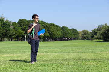 asian student in park with book and note in Bangkok Thailand