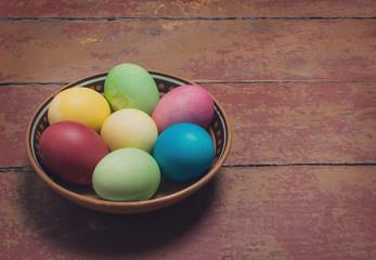 Multi-colored Easter eggs in a bowl. Retro