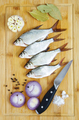 fresh water fish - young bream with garlic and spices