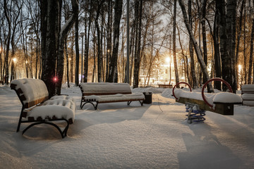 benches covered snow