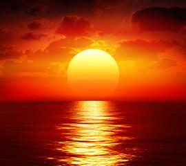 Garden Poster Brown sunset over calm sea