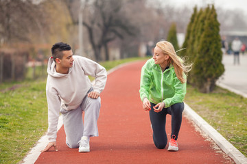 Two young athletes warming up for running