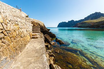 Turquoise water of Cala San Vicente beach, Majorca island, Spain