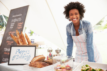 Female Bakery Stall Holder At Farmers Fresh Food Market