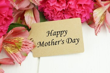 Happy Mother's Day gift tag close up with pink flowers