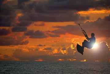 Kite surfing at sunset