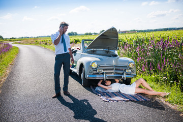 The newlyweds have a car breakdown.