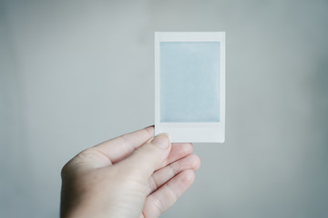 polaroid developing in a woman's hand
