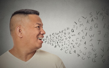 man talking with alphabet letters coming out of open mouth