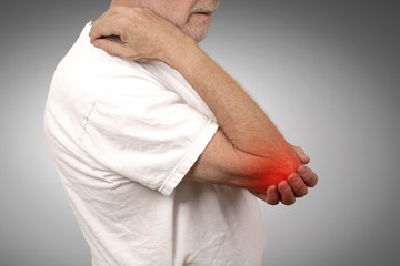 senior man with painful elbow inflammation colored in red