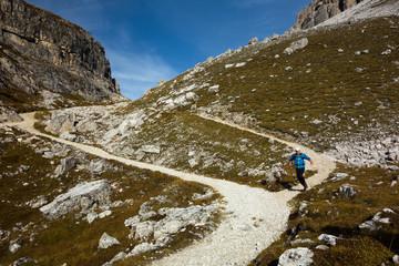 Man running downhill the trail
