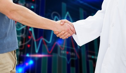 Mid section of a doctor and patient shaking hands