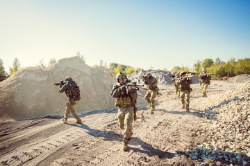 Soldiers team is fighting on the territory occupied by the enemy