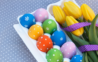 Easter eggs in the package with flowers