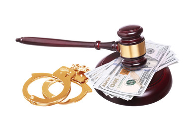 judge gavel and gold handcuffs with money isolated on white back