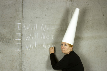 Woman with Dunce Cap Writing I WILL NOT