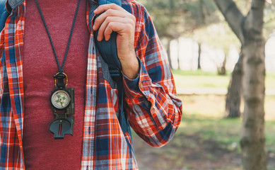 Traveler man with a compass
