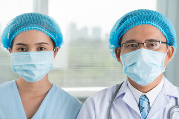 Surgeon and his female assistant