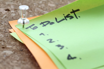 close up on pin and to do list word on sticky note with cork boa