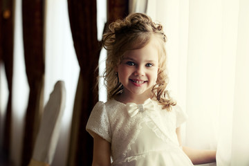 Portrait of adorable little girl with curls