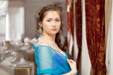 Elegant young girl posing in restaurant