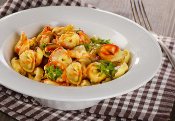 Ravioli pasta with  sauce and herbs.