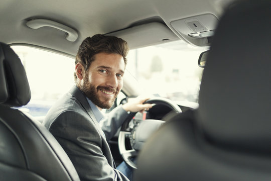 Portrait of man in his car. looking at camera