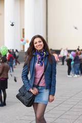 Cheerful girl walking through street