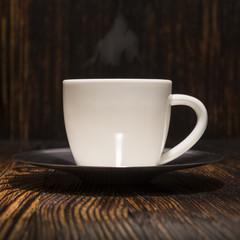 cup of coffee on a wooden background