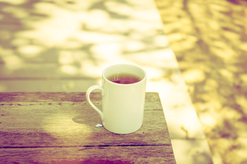 Tea cup on wood - Vintage effect style pictures
